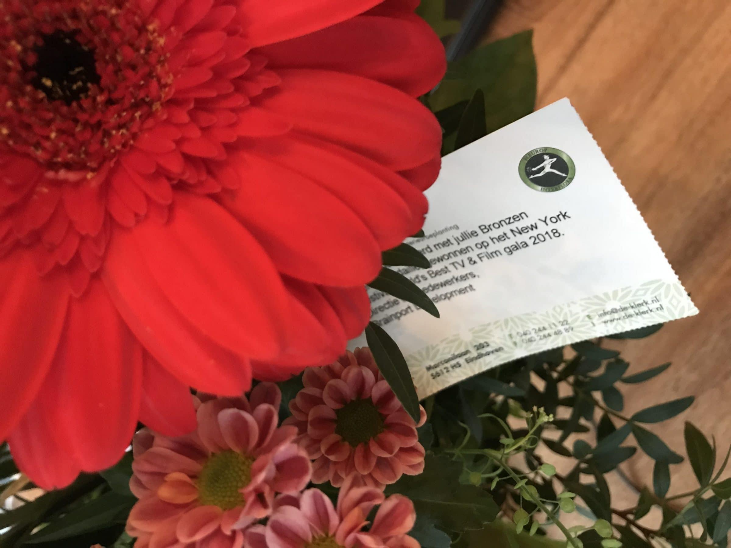 Bos bloemen als compliment voor de prijswinst